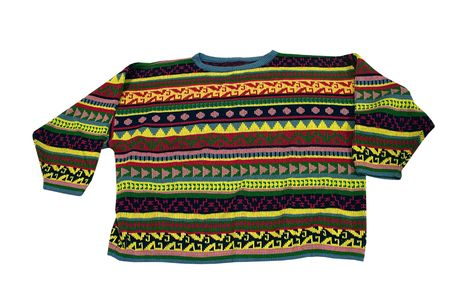 a brightly colored sweater on a white background