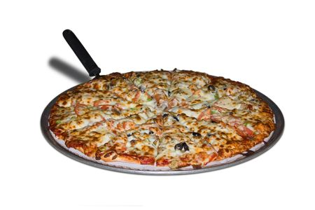 a pizza on a tray isolated on white photo