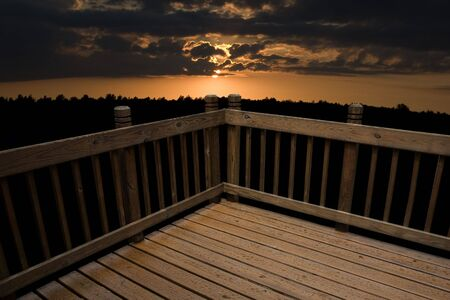 a deck against a sunset background