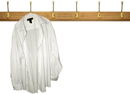 coat rack: a lone shirt haning on a coat rack Stock Photo