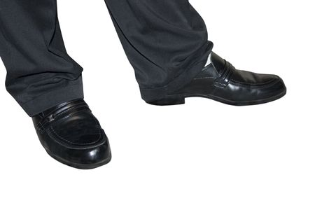 a pair of feet with dressy shoes on