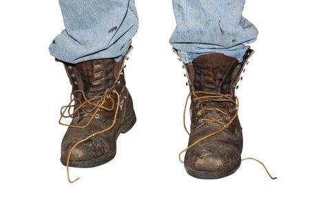 誰か汚れたブーツを履いて 写真素材