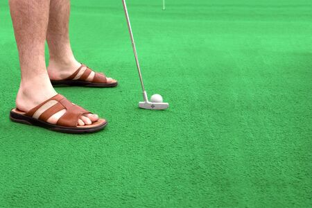 lining up: a man lining up a putt on a green Stock Photo