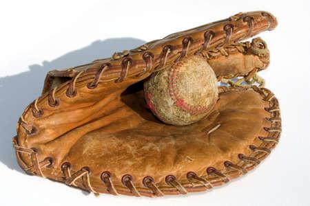 mitt: an old baseball in an old mitt Stock Photo