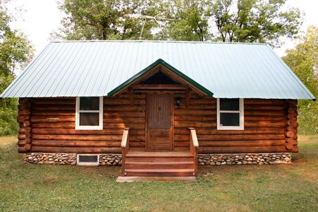 a little rustic log cabin in the woods