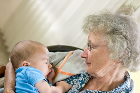 a grandmother holding a new little grandson photo