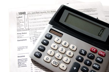 tax papers with a calculator on top Reklamní fotografie