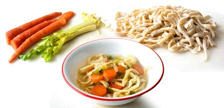 A bowl of homemade noodle soup isolated on white photo