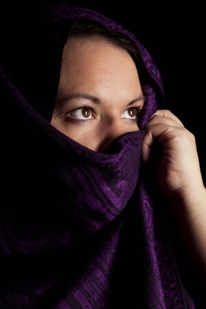 burka: A young lady with a burka wrapped around her face