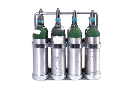 a case of 8 oxygen tanks isolated on white Reklamní fotografie