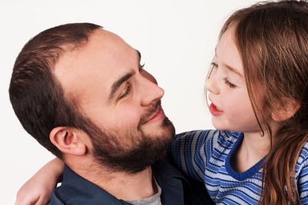 talk: a father and young daughter having a conversation Stock Photo