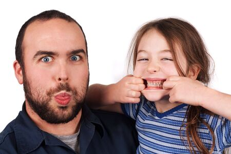 silly: a father and daughter with silly faces