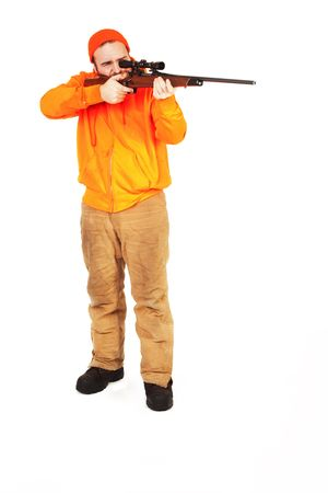 positioned: a man with a riffle positioned to shoot isolated