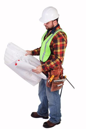 engineering clipboard: an isolated construction worker looking at some blueprints
