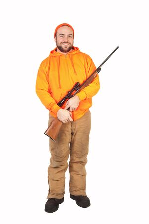 isolated hunter smiling and holding his riffle