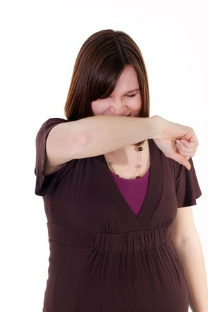 a pretty pregnant sneezing into her arm Stock Photo - 6515372