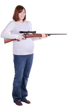 riffle: a pregnant lady smiling and holding a riffle Stock Photo