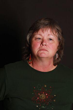 a sorrowful looking lady staring off camera Фото со стока