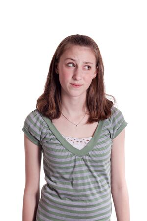 a young teenage girl at a computer with a disgusted face Stock Photo - 6663153
