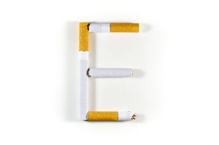 "Cigarettes folded in the shape of the letter ""E"" on a white background Reklamní fotografie"