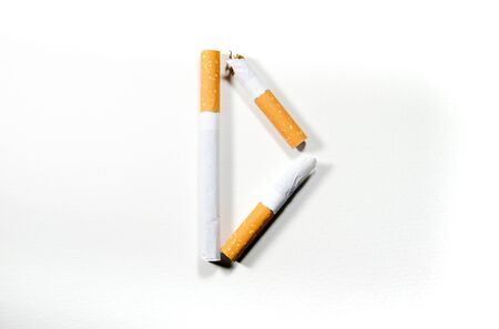 Cigarettes folded in the shape of the letter