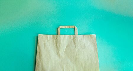 Close-up eco-friendly paper bag on blue