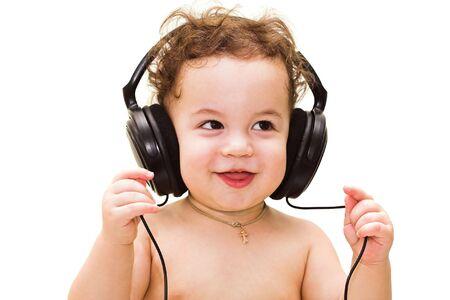 happy baby with headphones on white background
