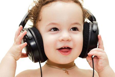 Happy singing baby wearing big black headphones