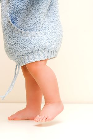 little  walking in blue bathrobe Stock Photo