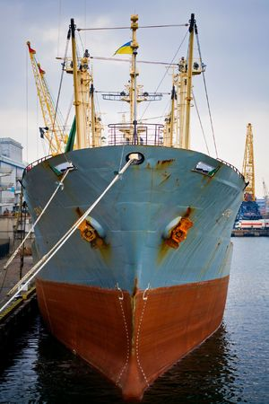 importation: Big ship standing in the port by the see waiting for cargo Stock Photo