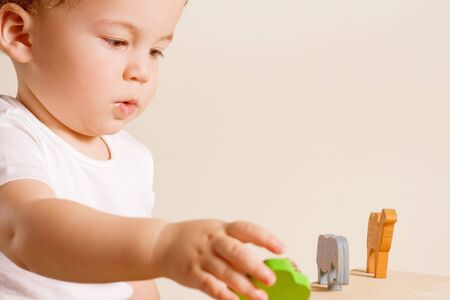 small boy playing with his colorful toys