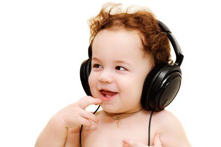 Happy singing baby wearing big black headphones photo