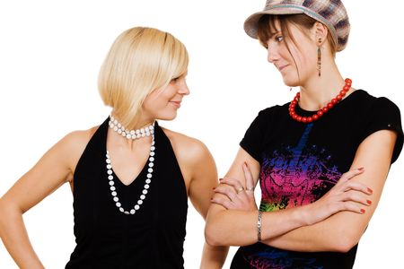 enmity: Two young girls looking at each other on white background