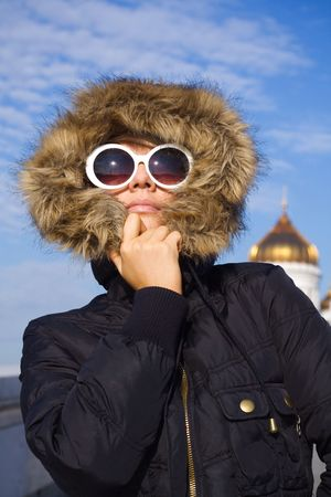 Beautiful girl in big white sun glasses and black jacket photo