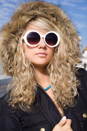 Beautiful blonde girl in big white sun glasses photo