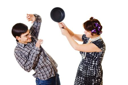 argues: Housewife attacking a man with a pan on white background Stock Photo