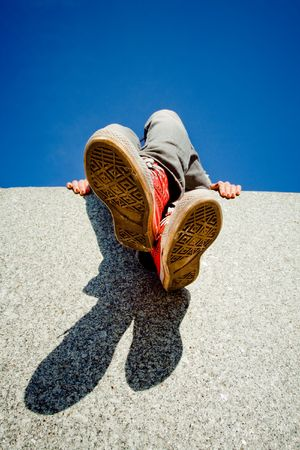 girl legs: Girl legs in red sneakers against blue sky