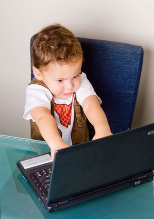 Small boy playing with a black notebook computer Stock Photo - 3830656