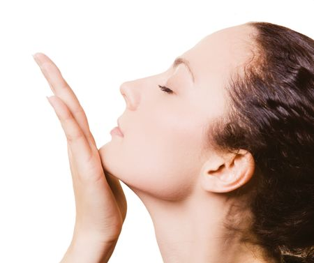Young beautiful girl face with hand on white background