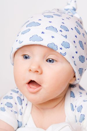 Small cute surprised child in blue pajama Stock Photo