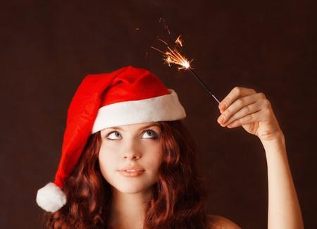 Young beautiful girl in santa claus hat