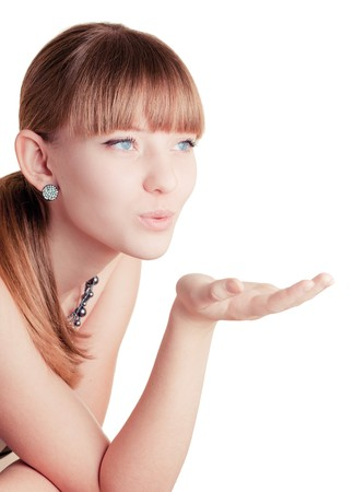 Young girl making blow kiss on white background Stock Photo