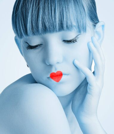 Pretty young girl with red heart on white background