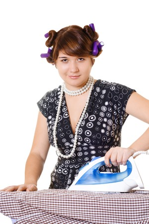 Pretty housewife is ironing a shirt on white background Stock Photo - 4251798