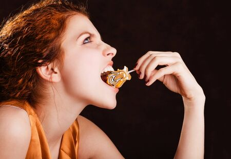 Young pretty girl eating a yellow candy Stock Photo - 4374895