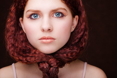 Pretty young girl with red tied hair photo