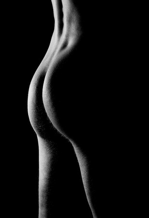 Man buttock and back on black background
