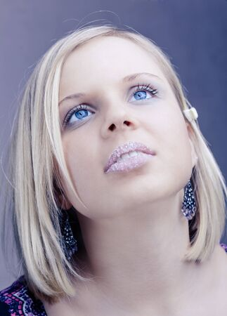 Young pretty blond girl with blue eyes photo