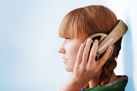 Young pretty girl  head with big headphones