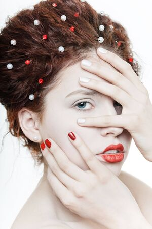 finger to lips: Young pretty girl with red lips on white backgound Stock Photo